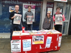 Party members selling 'The Socialist' newspaper - the Socialist Voice of workers and youth
