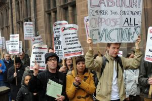 Anti-bedroom tax campaigners marching against evictions