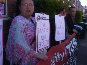 Three TUSC candidates (Sarah Smith, Nicky Downes and Lee Cooper) join the protest