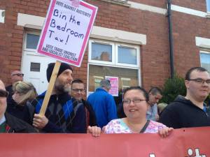 Sarah Smith with other anti bedroom tax campaigners stopping an eviction